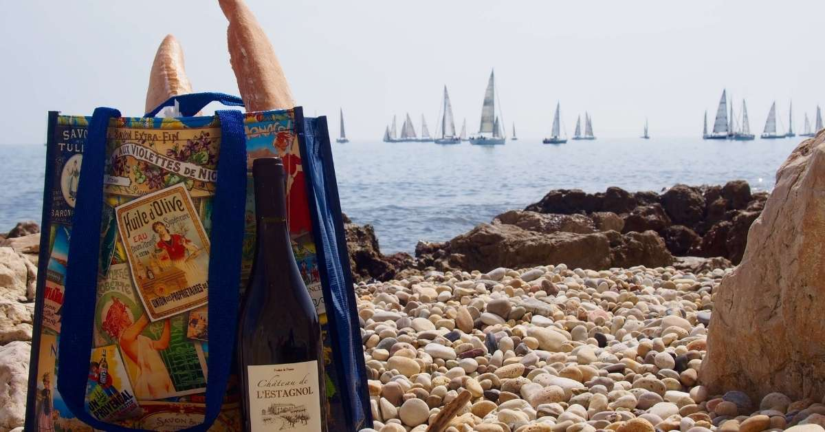 Bag with French writing on it, a baguette and a bottle of wine. Are you a proper Francophile episode.