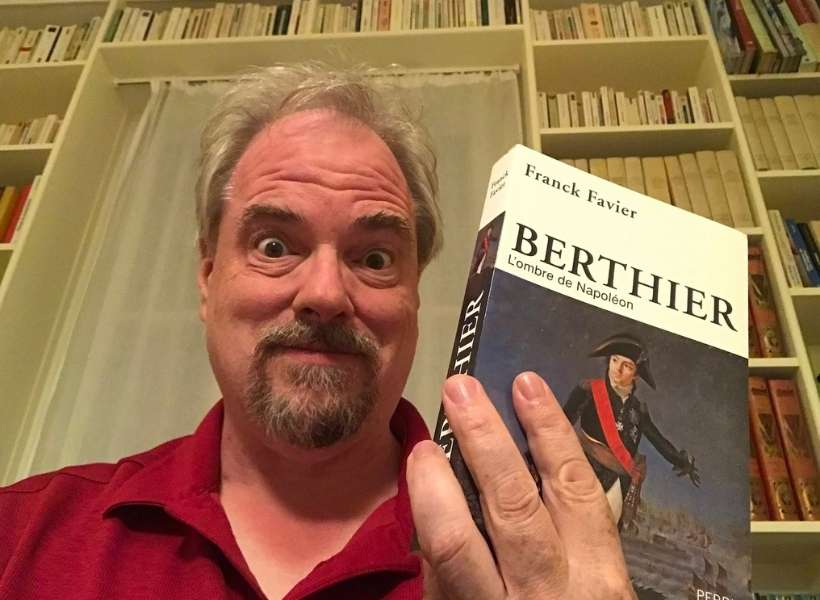 Kurt Weihs holding a book about Napoleon