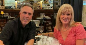 Joni and Steve Goldin sitting at a restaurant in Paris: first time in Paris trip report episode